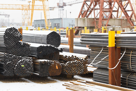 metal pipes: storage of metal pipes in outdoor warehouse with gantry cranes