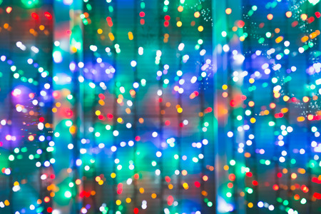home accent: blurred christmas lights on window in night Stock Photo