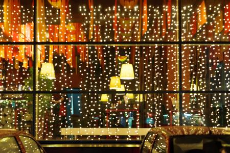 Xmas illumination of restaurant window in night Stok Fotoğraf