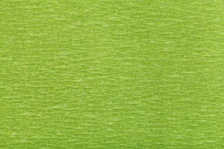 fibrous: background from fibrous structure color green paper close up