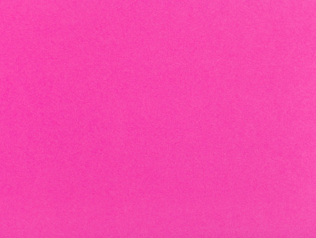 background from sheet of color dark pink paper close up photo