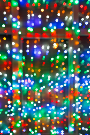 home accent: defocused Xmas lights on window in night