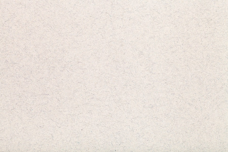 background from sheet of light brown color fiber paper close up Stock Photo