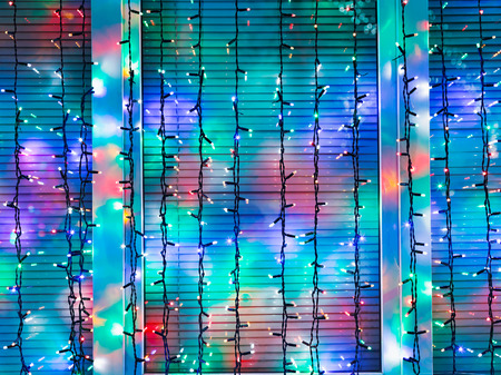 home accent: outdoor Christmas garlands decorate window in night Stock Photo