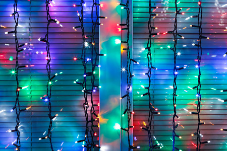 home accent: outdoor Christmas multi-color electric lamps decorate window in night