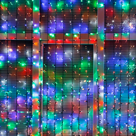 home accent: outdoor Xmas lamp strings decorate window in night Stock Photo