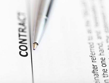 tip up: agreement and tip of silver pen close up Stock Photo