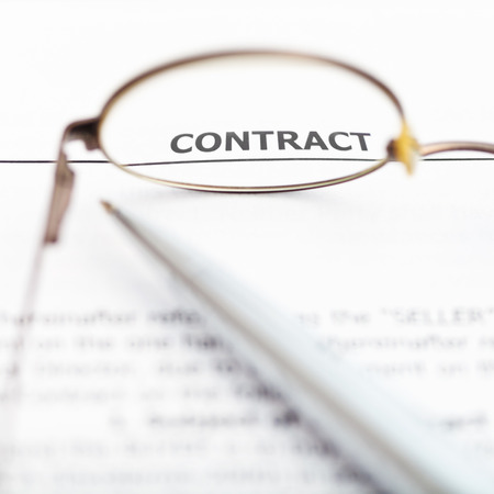conclude: view of sales contract through eyeglasses close up Stock Photo