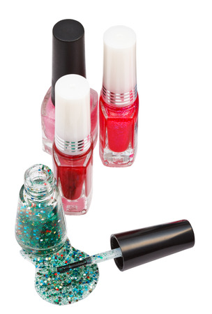 lacquer: nail polish bottles and spilled green lacquer isolated on white Stock Photo