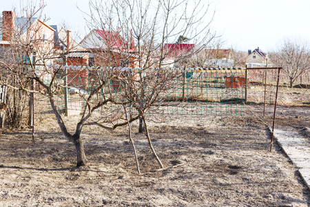 an agricultural district: empty country backyard gardens in early spring day Stock Photo