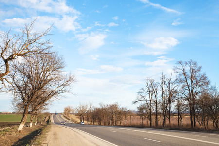 an agricultural district: highway in country district in early spring day