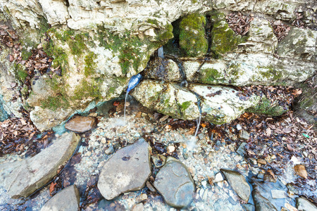 water spring: natural water spring from rock in caucasus mountain