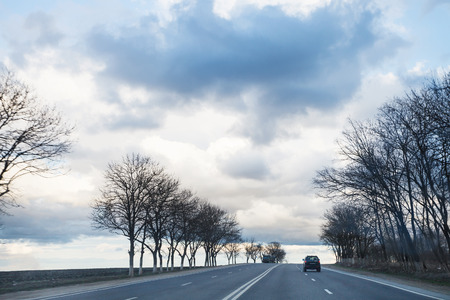 krasnodar region: gray rainy clouds over highway in early spring evening Stock Photo