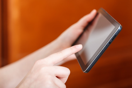 hall monitors: finger touching tablet pc screen in office