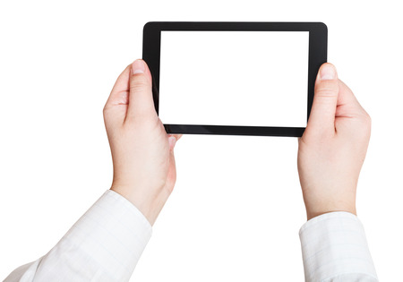 businessman hands holding touchscreen pc with cut out screen isolated on white background photo