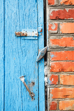 pawl: blue painted old wooden door with latches close up