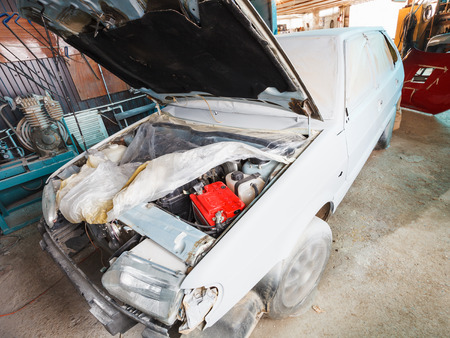 private parts: repairing of old car in small country garage