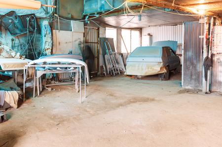 automobile workshop: village automobile workshop with old painted car