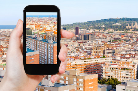 barcelona: travel concept - tourist taking photo of Barcelona skyline on mobile gadget, Spain Stock Photo