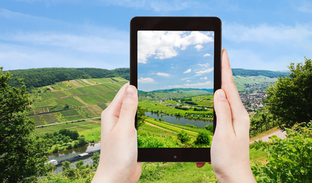 mosel: travel concept - tourist taking photo of Moselle valley and Mosel river in summer day, Germany on mobile gadget