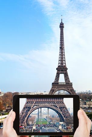 d'eiffel: travel concept - tourist taking photo of Champ de Mars, Pont d Iena and Eiffel Tower in Paris on mobile gadget, France