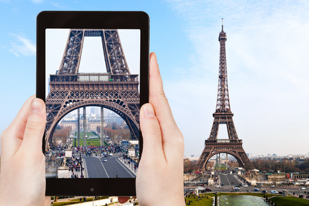 champ: travel concept - tourist taking photo of Champ de Mars and Eiffel Tower from Trocadero in Paris on mobile gadget, France