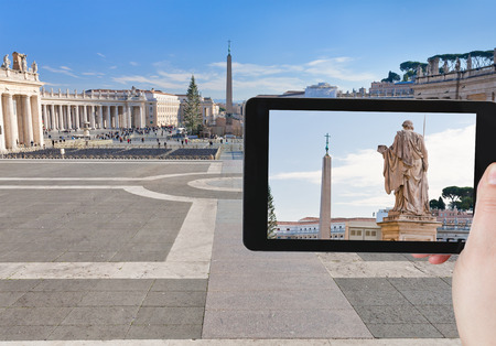 pio: travel concept - tourist taking photo of Egyptian obelisk on St.Peter Square from Piazza Pio, Rome, Italy on mobile gadget