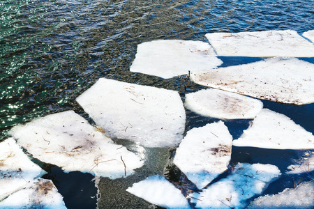 melting ice: melting ice floes in river in sunny spring day Stock Photo