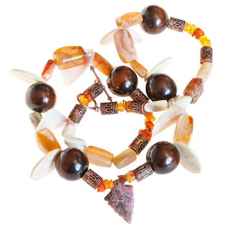 necklace from mineral stones (agate, amber,nacre) and wooden balls isolated on white background photo