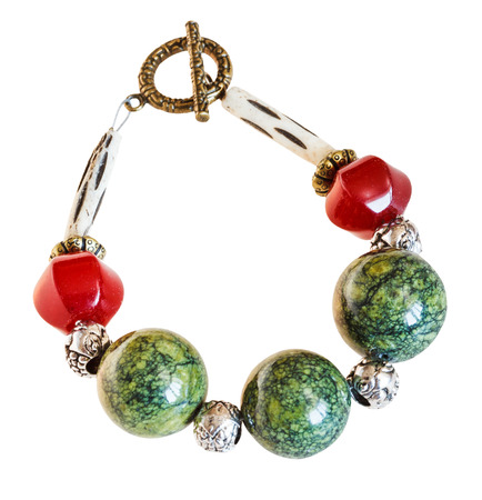 bracelet from red jade and green serpentine ophite stone beads isolated on white background photo