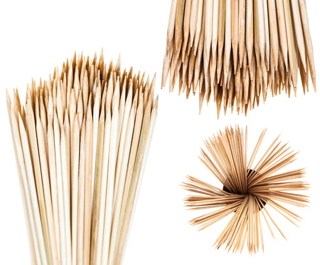 fan shaped: many wooden toothpicks isolated on white background