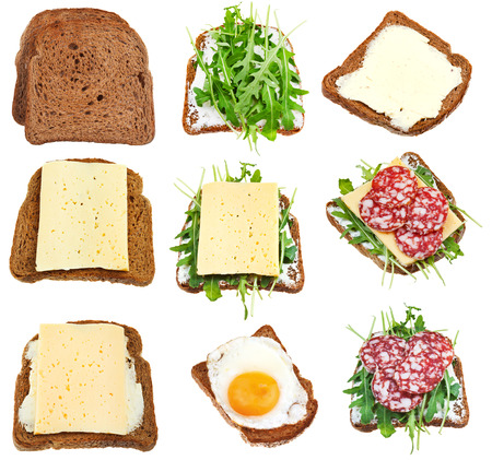 set of sandwiches from toasted brown bread isolated on white background