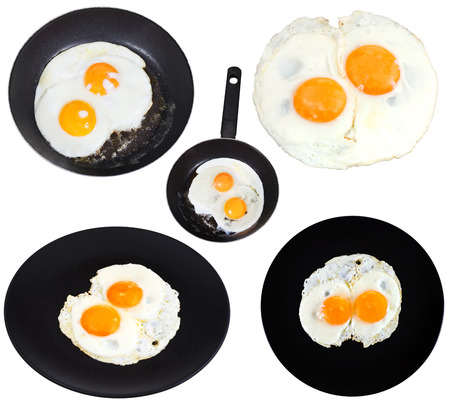 set from two fried eggs isolated on white background photo