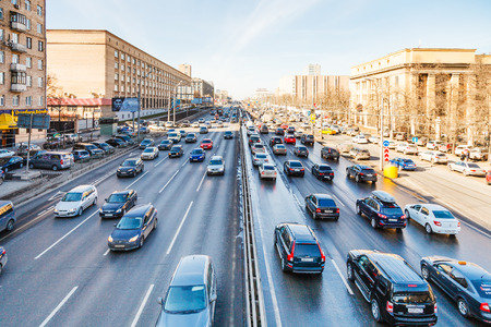 highway: MOSCOW, RUSSIA - MARCH 27, 2015: urban transport on Leningradskoye shosse in spring day. Leningradskoye Highway is a part of M10 federal highway Moscow – Saint Petersburg inside Moscow