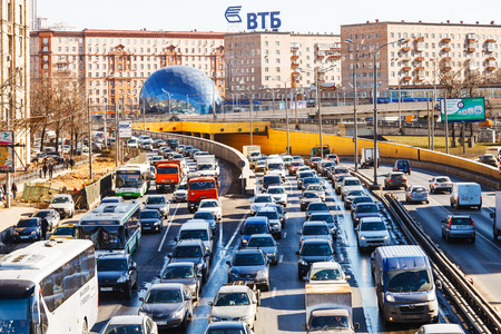 urban street: MOSCOW, RUSSIA - MARCH 27, 2015: above view Leningradskoye shosse in spring day. Leningrad highway - one of Moscows busiest highway, connects the center of Moscow with Sheremetyevo Airport Editorial
