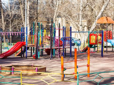 municipal court: children playground in urban yard in spring