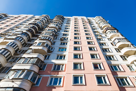 multi storey: bottom view of facade of modern multi storey house