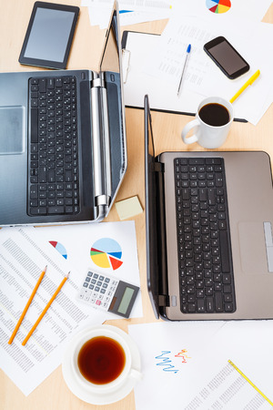 financial planning: business workflow - top view of table with tools in modern office