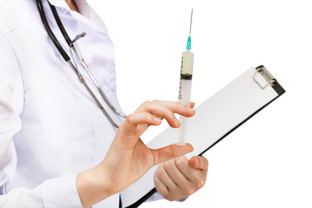 doctor holds syringe and clipboard isolated on white background photo