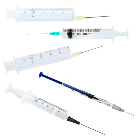 set of empty medical plastic disposable syringes isolated on white background photo