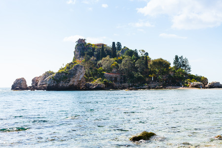 ionian island: TAORMINA, ITALY - APRIL 3, 2015: island Isola Bella in Ionian Sea, Sicily, Italy. Also known as The Pearl of the Ionian Sea in 1990 the island being turned into nature reserve, administrated by WWF