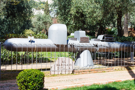 manned: TAORMINA, ITALY - APRIL 3, 2015: memorial to Italian seamen installed on 1993 in urban park. The monument is made from a restored in 1991 the old submarine - maiale manned torpedo (Human torpedo)