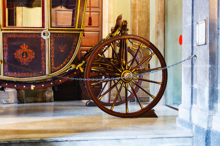 sant agata: CATANIA, ITALY - APRIL 5, 2015: wooden coach in Town Hall of Catania. This carriage is used for the urban Festivals, such as of the feast of St. Agatha in Catania, Sicily