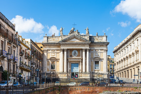 2nd century: CATANIA, ITALY - APRIL 5, 2015: ancient roman amphitheater (Anfiteatro Romano) and Church San Biagio in Piazza Stesicoro in Catania, Sicily. The arena dates from the 2nd century AD