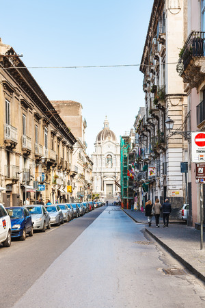 santagata: CATANIA, ITALY - APRIL 5, 2015: people on via Giuseppe Garibaldi and dome of Saint Agatha Cathedral in Catania, Sicily, Italy. Cathedral was originally constructed in 1078-1093.