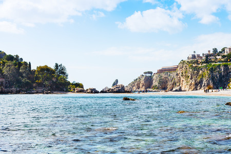 bella: Cape of Taormina and Isola Bella beach in Sicily, Italy in spring