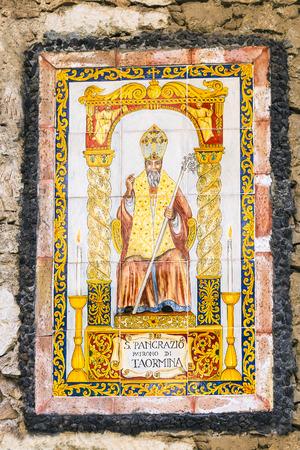 patron: icon of Saint Pancras or Pancratius (San Pancrazio) of Taormita - patron Saint of Taormina town on the urban house wall, Sicily, Italy