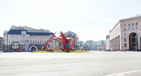 war decoration: MOSCOW, RUSSIA - MAY 7, 2015: red star monument and urban decoration in honor of the 70 anniversary of the victory in World War II on Lubyanskaya Square in Moscow city in May