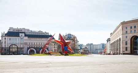world war ii: MOSCOW, RUSSIA - MAY 7, 2015: red star sculpture in urban garden in honor of the 70 anniversary of the victory in World War II on Lubyanskaya Square in Moscow city in May