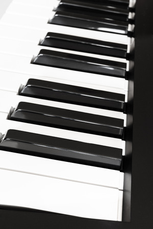 side keys: side view of black and white keys of musical digital keyboard close up Stock Photo